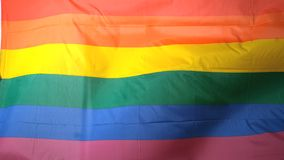 Rainbow flag blowing in the breeze Stock Photo
