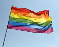 Rainbow flag on blue sky.  royalty free stock photos