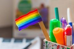 Rainbow flag on a desk Stock Photos