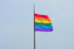 Rainbow Flag flying in wind Stock Photo