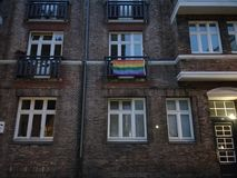 Rainbow flag hoisted at a building stock images