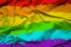Rainbow flag of LGBTQ for Pride month on fabric texture with ripple.  royalty free stock images