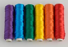 Rainbow flag. LGTB symbol. Rainbow flag. LGTB symbol made with colorful spools of thread Royalty Free Stock Photo
