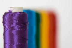 Rainbow flag. LGTB symbol. Rainbow flag. LGTB symbol made with colorful spools of thread. Selective focus Royalty Free Stock Photo