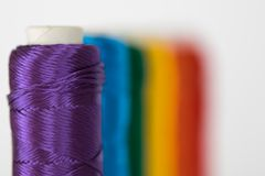 Rainbow flag. LGTB symbol. Rainbow flag. LGTB symbol made with colorful spools of thread. Selective focus Stock Image