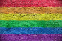 Rainbow flag. Over old brick wall royalty free stock photo