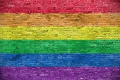 Rainbow flag. Over old brick wall royalty free stock photo