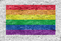 Rainbow flag painted over brick wall Royalty Free Stock Photos