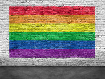 Rainbow flag painted over white brick wall Royalty Free Stock Images