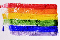 Rainbow flag painted in a textured background royalty free stock image