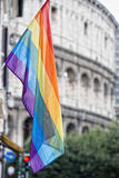 Rainbow Flag on rome coliseum background Royalty Free Stock Photography