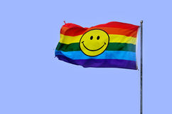 Rainbow flag with smiley face Royalty Free Stock Images