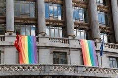 Rainbow flags in building Stock Photos
