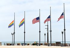 A rainbow flags and flags of US in Chicago, USA royalty free stock photography
