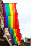 Rainbow flags on houses Stock Photography