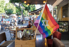 Rainbow flags with the Jewish star of David at undefined cafe. In Israel stock photo
