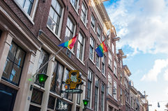 Rainbow flags on the medival building in red light district, the Netherlands. Stock Images