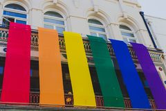 Rainbow flags off a building in Dublin`s main street Grafton Str royalty free stock photography