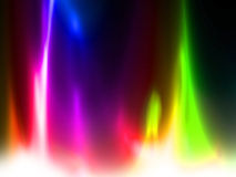 Rainbow flames. On a dark black background Royalty Free Stock Images