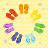 Rainbow flip flops in circle on the sand. Stock Photo