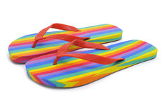 Rainbow flip-flops. A pair of rainbow flip-flops on a white background stock image