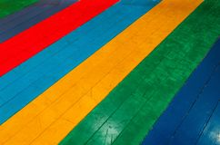 Rainbow floor wooden texture, children`s corner. Stock Photography