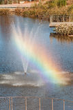 Rainbow Forms From Fountain Spray At Public Park Royalty Free Stock Images
