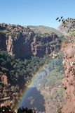 Rainbow in an African canyon royalty free stock photography