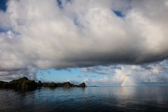 Rainbow Forms Near Limestone Islands in Raja Ampat Royalty Free Stock Photography