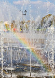 Rainbow in a fountain. On a background of the blue sky Stock Images