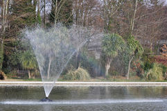 Rainbow Fountain. Fountain in boating lake showing a nice rainbow Stock Photo