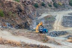 Digger of granite quarry Stock Photo
