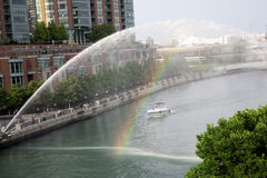 Rainbow through the fountain in downtown Chicago Stock Images