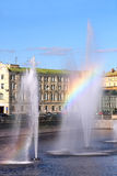 Rainbow in a fountain in the middle of river Royalty Free Stock Photo