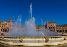 Rainbow in the fountain in the Plaza of Spain in Seville stock image