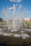 Rainbow in fountain splashes. In the park Royalty Free Stock Photography