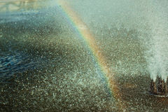 Rainbow in the fountain spray. Photo clear rainbow among the drops of water in a fountain Stock Photo