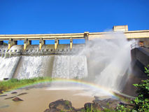Rainbow in front of a dam wall. Shot in Hazelmere Dam Nature Reserve, near Durban, North Coast of Kwazulu-Natal, South Africa Royalty Free Stock Photography
