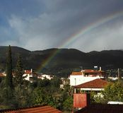 Rainbow over village Royalty Free Stock Images