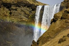 Rainbow in front of Skogafoss waterfall, Iceland royalty free stock photos