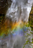 Rainbow in front of waterfall Royalty Free Stock Image
