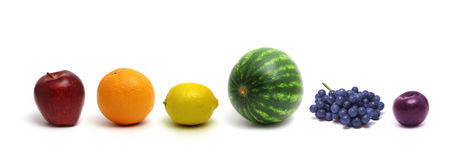 Rainbow Fruit. A row of fruit arranged in the colors of the rainbow Stock Photos