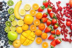 Rainbow fruits background royalty free stock photography