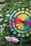 Rainbow garden spinner on an allotment stock photo