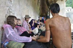 Rainbow gathering in Palenque. Palenque, Chiapas, Mexico - December 21, 2012: Individuals participating in a Rainbow gathering unite in a hymn at exactly 1:11 pm Stock Images