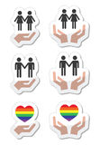 Rainbow, gay and lesbian symbols in heart with hands Stock Photos
