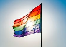 Rainbow Gay Pride Flag on blue sky background, Miami Beach, Florida, USA royalty free stock photo