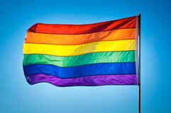 Rainbow Gay Pride Flag on blue sky background, Miami Beach. Florida, USA stock photos