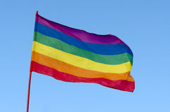 Rainbow Gay Pride Flag on blue sky background, USA. Rainbow gay and lesbians flag (LGBT movement) waving on the blue sky background in Miami Beach, Florida, USA royalty free stock photos