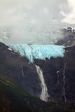Rainbow Glacier with waterfall and low cloud, Chilkat Inlet, near Haines, AK Stock Photography
